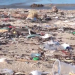 the-famous-kuta-beach-in-bali,-indonesian-covered-with-plastic-waste-(video)
